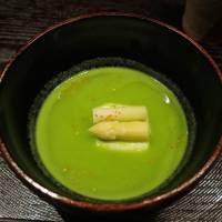 A vivid jade-green soup made from crushed peas, served with white asparagus. | ROBBIE SWINNERTON