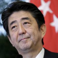 Prime Minister Shinzo Abe gives a statement after a bilateral meeting with Singaporean counterpart Lee Hsien Loong on the sidelines of the annual Shangri-La Dialogue in the city-state on Saturday. | AP