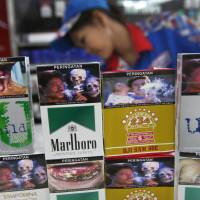 Indonesia cigarettes flout graphic ad law