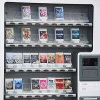 Packs of quasi-legal herbs are shown in a vending machine in Aichi Prefecture in February 2013. | KYODO