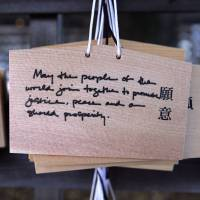 A wooden votive tablet with wishes written by visiting U.S. President Barack Obama hangs at Meiji Shrine in Tokyo on April 24. The tablet says: 'May the people of the world join together to promote justice, peace and our shared prosperity.' | AFP-JIJI