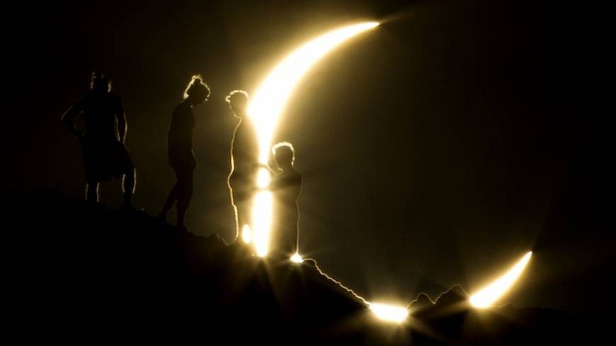 "People watch an annular eclipse from Phoenix, Arizona, in May 2012. The event, also known as a ""Ring of Fire Eclipse,"" was visible in wide areas across Japan, China and elsewhere in the Asia-Pacific region before moving across the ocean to become visible in parts of the western United States."