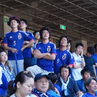 Anxiety spreads after Cote d'Ivoire scores two quick goals to take the lead against Japan during a live broadcast of their World Cup match in Brazil, at Nissan Stadium in Yokohama on Sunday. | KAZUAKI NAGATA
