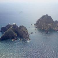 These disputed rocks off Shimane Prefecture are claimed by Japan but controlled by South Korea. | KYODO