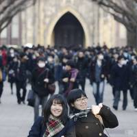 The relief is palpable after college applicants complete their two days of entrance examinations at the University of Tokyo in January 2013. | KYODO