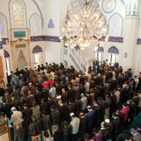 A piece of home: The multinational congregation at the Tokyo Camii attends Friday prayer. | COURTESY OF TOKYO CAMII