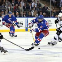 On the move: New York's Martin St. Louis controls the puck against Los Angeles in Game 4 on Wednesday night. The Rangers won 2-1 and now trail 3-1 in the series. | REUTERS