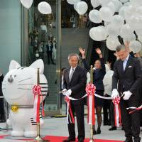 Mori Building Co. President Shingo Tsuji and Arnaud de Saint-Exupery, general manager of the new luxury hotel Andaz Tokyo, cut the ribbon at the opening of the Toranomon Hills complex on Wednesday. | AFP-JIJI