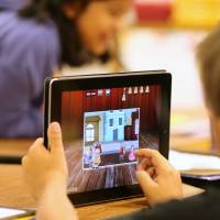 Hooked on apps: A child uses an iPad as part of a classroom activity. Parents who worry their children spend too much time looking at screens are looking to apps to limit their kids' use of mobile devices. | BLOOMBERG