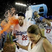 Shower time: Los Angeles' Clayton Kershaw gets drenched by teammates following his no-hitter against Colorado on Wednesday night. The Dodgers beat the Rockies 8-0. | AP