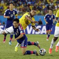 Back to the drawing board: Japan's Shinji Kagawa (10) and his teammates didn't rise to the occasion at the World Cup in Brazil.  | AP