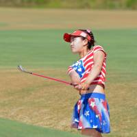 Too cool for school: Lucy Li hits a shot during the first round of the U.S. Women's Open on Thursday. Li shot a 78. | REUTERS