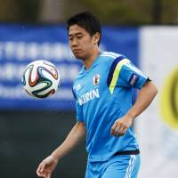 Fine tuning: Shinji Kagawa juggles a ball during a training session in Clearwater, Florida on Sunday. | REUTERS
