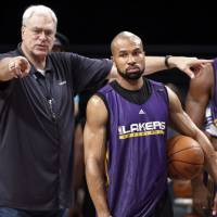 Mentor and protege: Derek Fisher, seen here with Phil Jackson while a member of the Los Angeles Lakers in 2010, has agreed to become the head coach of the New York Knicks. | AP