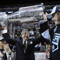Building a dynasty: Kings owner Philip Anschutz holds the Stanley Cup on Friday after his team captured the NHL title for the second time in three seasons. | REUTERS/USA TODAY