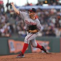 Sharp: Washington's Stephen Strasburg fires a pitch against San Francisco in the first inning on Monday night. The Nationals downed the Giants 9-2. | REUTERS