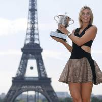 On to the next one: French Open champion Maria Sharapova has already set her sights on winning the title at Wimbledon. | AFP-JIJI