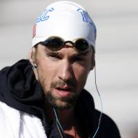Tuned in: Michael Phelps makes his way to the starting blocks for Saturday's 200-meter freestyle final. | REUTERS/USA TODAY