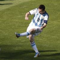 Moment of Messi magic sends Argentina into second round