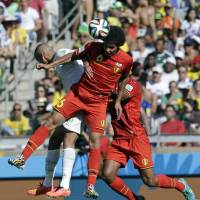 Heat of battle: Belgium's Axel Witsel wins a header during Tuesday's 2-1 win over Algeria. | AP