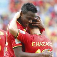 Good work: Belgium's Eden Hazard hugs Divock Origi after his goal against Russia on Sunday. | REUTERS