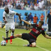 Intensity: DaMarcus Beasley of the U.S. (left) vies for the ball with Germany's Thomas Mueller on Thursday in Recife, Brazil. | REUTERS