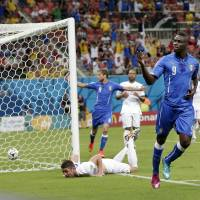 Super Mario: Italy striker Mario Balotelli celebrates after heading his team in front early in the second half of Italy's 2-1 win over England in Group D on Saturday. | AP
