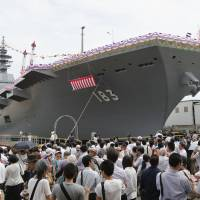 "People attend the launch of the Izumo ""flat-topped destroyer"" in Yokohama in August 2013."