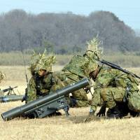 Self-Defense Force troops prepare a Kawasaki Heavy Industries-made 87 MAT anti-tank missile launcher during a live drill at Camp Narashino, Chiba Prefecture, in January. | YOSHIAKI MIURA
