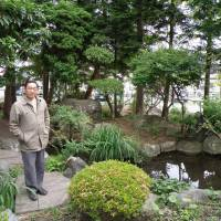 Falsely accused: Yoshiyuki Kono stands in the yard of his home in June 2009. | KYODO