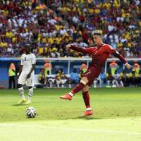 Not enough: Portugal's Ronaldo scores against Ghana in the second half on Thursday in Brasilia. Portugal won 2-1. | REUTERS