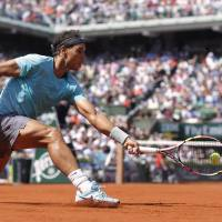 King on his court: Rafael Nadal plays a shot from Argentina's Leonardo Mayer during their third-round match at the French Open on Saturday. Nadal won 6-2, 7-5, 6-2. | AFP-JIJI