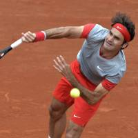 Gulbis bounces Federer out of French Open in fourth round