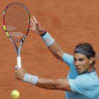 Nadal blows away Lajovic to make quarters