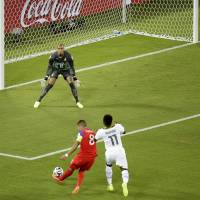 Early strike: Clint Dempsey of the United States moves in to score against Ghana goalkeeper Adam Kwarasey in Natal, Brazil, on Monday. The U.S. won 2-1. | AP