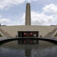 Visitors walk around a pool outside the main entrance to the National World War I Museum at Liberty Memorial in Kansas City, Missouri. | AP