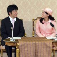 Cause to celebrate: Princess Noriko, second daughter of the late Prince Takamado and Princess Hisako, attends a news conference with fiance Kunimaro Senge at the Imperial Household Agency in Tokyo last week. Princess Noriko is engaged to Senge, eldest son of the chief priest of grand shrine Izumo-Taisha. | REUTERS