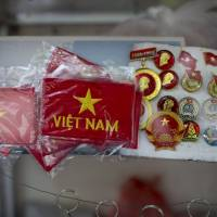 Selling pride: Vietnam flags and badges are displayed at a tourist shop in Hanoi, where the territorial dispute over the Paracel Islands has stoked heated anti-Chinese demonstrations. | BLOOMBERG