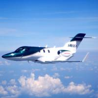 A HondaJet made by Honda Aircraft, auto giant Honda Motor Co.'s aviation subsidiary, is shown during a test flight June 27 over Greensboro, North Carolina. HONDA MOTOR/afp-jiji