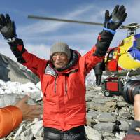 Adventurer Yuichiro Miura arrives at a base camp before successfully scaling Mount Everest in May last year. | KYODO