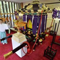 A newly built 'gohoren,' a phoenix float that will be used during Ikukunitama Shrine's traditional Shinto ritual for the first time in 70 years, is displayed Tuesday in Tennoji Ward, Osaka. | KYODO