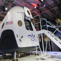 SpaceX unveils private space taxi to the stars