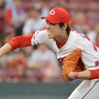 Times are tough: Kenta Maeda and the Carp haven't won many games against Pacific League teams | KYODO