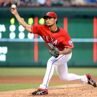 A win is a win: Rangers starter Yu Darvish pitches against the Indians on Friday in Cleveland. Texas won 6-4. | KYODO