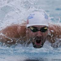 Phelps shares 100m butterfly title