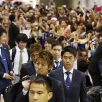 Fans turn out to greet Japan team