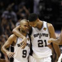 Ready for anything: Tony Parker (left), Tim Duncan (center), Boris Diaw and the rest of the Spurs played through the distractions in Game 1 of the NBA Finals on Thursday in San Antonio. | REUTERS