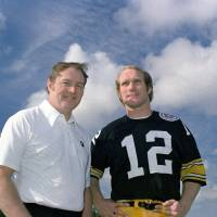 Giant of the game: Legendary Steelers coach Chuck Noll (left) stands with quarterback Terry Bradshaw in a December 1975 file photo. | AP