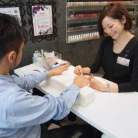 A man gets his nails polished at a salon in Tokyo. | KYODO