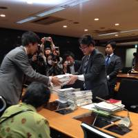 Yuya Kamoshita, who fled Iwaki, Fukushima Prefecture, submits a petition to the Cabinet Office on April 25, demanding help tailored to the needs of nuclear evacuees. It was signed by 16,000 fellow evacuees. | HINAN SEIKATSU O MAMORU KAI